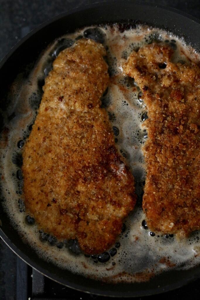 Frying Bavarian Pork Schnitzel