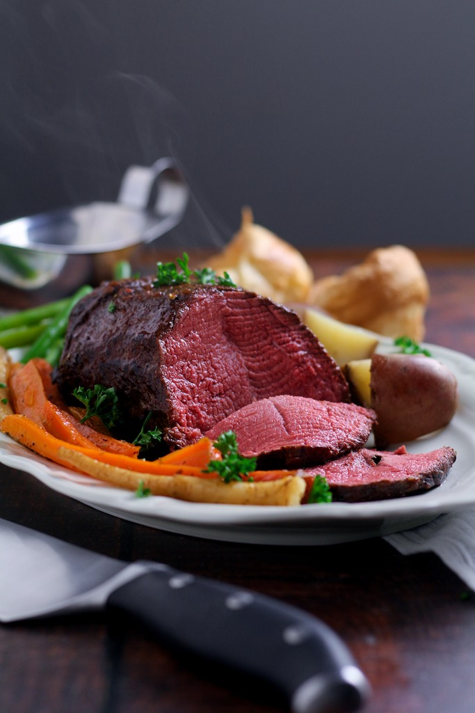 Perfectly tender, rosy roast beef is easier than you think! Slow Roast Beef where the beef is seared before roasting at a very low temperature produces juicy, delicious beef every time.