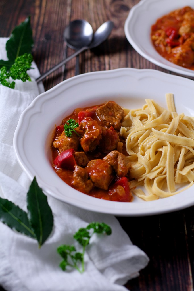 If you've ever travelled to Hungary you are sure to have eaten plenty of this famous dish. Similar to goulash, Hungarian Pork Stew or Pörkölt is thick and hearty with a rich tomatoey sauce, perfect as a winter warmer.